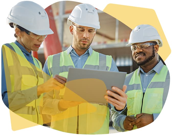 contractors reviewing construction accounting software on a computer